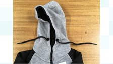 Children's hoodies with banned neck cords seized at Warwickshire market