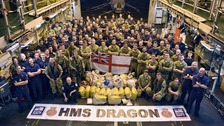 HMS Dragon crew with drugs seized from a sailing vessel