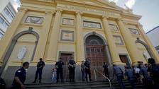 Police stand guard outside the Metropolitan Cathedral after a deadly shooting in Campinas