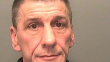 Paedophile arrested after hiding behind false wall