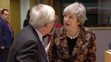 May says she had 'robust' exchange with Juncker