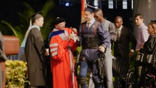 This student trained for years to walk on stage at his graduation