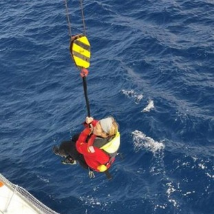 Susie being winched to safety by MRCC Chile