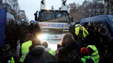 Water cannons and tear gas force 'yellow vests' off Champs-Elysees as protests continue in France