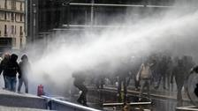 Tear gas used on anti-migration protesters at EU headquarters