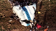 A bomb exploded on board the plane as it flew over Lockerbie, killing all 259 people on board.