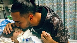 Ali Hassan with his two-year-old son Abdullah in a Sacramento hospital.