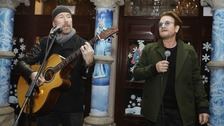 U2's The Edge and Bono joined the now traditional Christmas Eve charity busking session in Dublin
