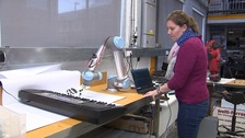 Researcher Josie Hughes with the robot hand