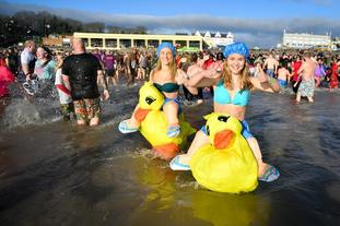 It was a colourful scene at the Barry Island New Year's Day swim in the Vale of Glamorgan, Wales
