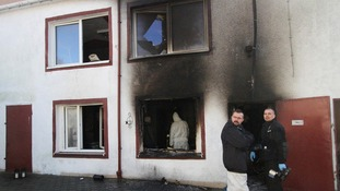 Investigators at the scene of the fire at the escape room in Koszalin, in northern Poland.