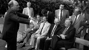 Labour leader Neil Kinnock calls for order from his Shadow Cabinet. Seated in the front are left: Dr. John Cunningham, Derek Foster, Gerald Kaufman and Roy Hattersley. Standing behind are from left: Bryan Davies, Secretry of Parliamentary Labour Party, Jack Straw, Gordon Brown and Lord Cledwyn