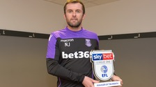 Nathan Jones poses with his award.
