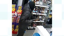 Police searching for armed robber after shop worker threatened with shotgun