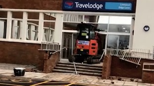 Footage has emerged of a digger driving into the Travel Lodge