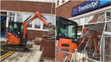 Police hunt for digger driver after Travelodge reception destroyed