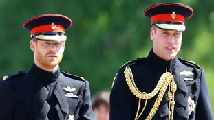 Prince Harry walking alongside his brother on his wedding day.