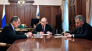 Russian President Vladimir Putin meets to discuss the treaty with Foreign Minister Sergey Lavrov (left), and Defence Minister Sergei Shoigu (right).