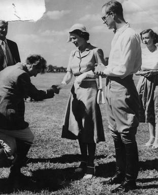 Princess Elizabeth meeting members of the Nyeri polo club with the Duke of Edinburgh, hours before she became Queen