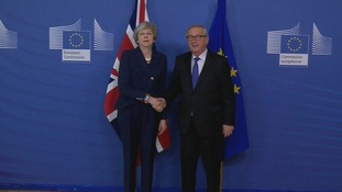 An awkward handshake in Brussels as Theresa May meets European Commission president Jean-Claude Juncker.