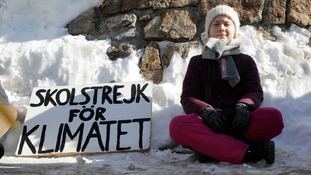 Greta Thunberg, with her 'School Strike for Climate' banner.