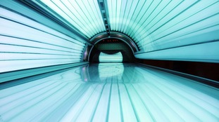 A Derbyshire MP is calling for sunbeds to be banned in the UK