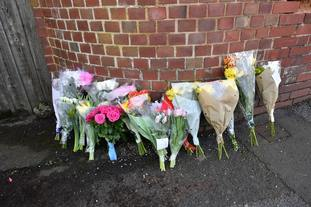 Floral tributes left outside 109 Cowick Lane, Exeter, where the bodies of twins Dick and Roger Carter, aged 84, were discovered