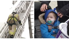Around 50 firefighters (left) took part in the climb to raise money for Harry (right).