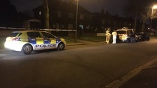 Two men injured after double shooting on housing estate