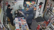 CCTV captures dramatic stand-off between shopkeeper and robbers