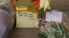 """Gone too young"" - Tributes are placed outside college where teenager was fatally stabbed"