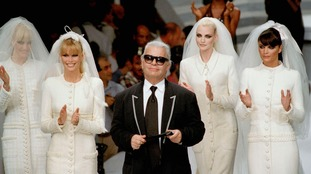 Karl Lagerfeld with models in Paris 1995.