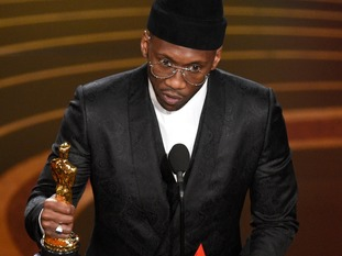 Mahershala Ali accepts the award for best performance by an actor in a supporting role for Green Book.