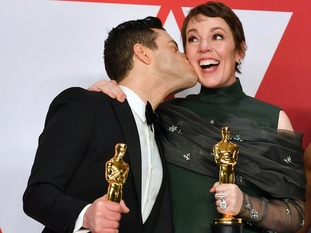 Fellow Oscar winner Rami Malek kissed Colman on the cheek in the press room following the ceremony.