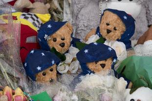 Four teddy bears close to the scene of the fire