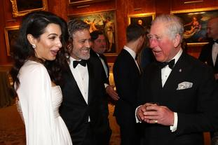The Prince of Wales speaks to Amal and George Clooney