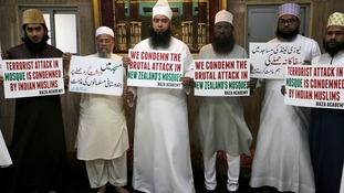 India: Indian Muslims hold placards during a condolence meeting and protest in Mumbai.