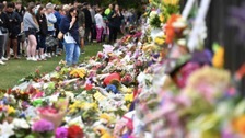 Mourners gather at a makeshift memorial in Christchurch