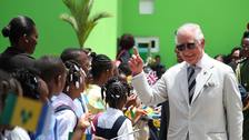 The Prince of Wales greets schoolchildren as he arrives at Argyle International Airport, St Vincent and the Grenadines