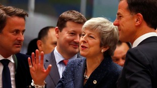 Mrs May with Dutch PM Mark Rutte, right, and Luxembourg's Prime Minister Xavier Bettel, left.