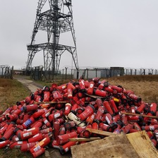 Dozens of fire extinguishers dumped near a pylon