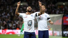 England's Raheem Sterling celebrates scoring his side's third goal of the game showing a t-shirt in memory of Damary Dawkins.
