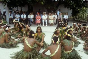 Queen Elizabeth II and the Duke of Edinburgh watching dancers in Kiribati