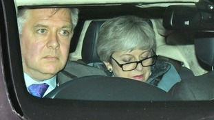 Theresa May leaves the House of Commons following the key Brexit votes.