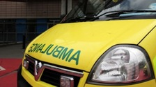 Paramedic hurt by stone thrown through ambulance window