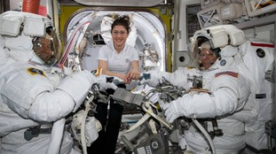 NASA astronaut Christina Koch (centre) assists fellow astronauts Nick Hague (left) and Anne McClain in their U.S. spacesuits.