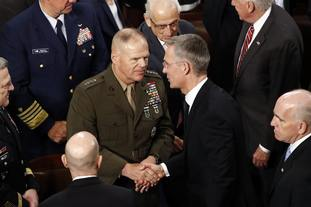 General Robert Neller, left, speaks with Jens Stoltenberg after the address