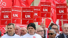 honda workers and placards