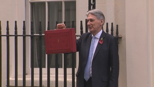 philip hammond holding up his red briefcase outside no11