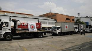 A convoy of trucks arrive with the first shipment International Federation of Red Cross and Red Crescent Societies humanitarian aid